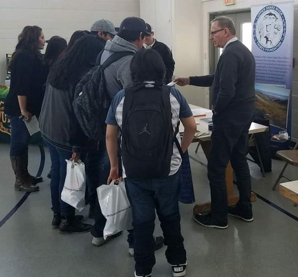 Bob visiting with the Fort McDermitt Paiute-Shoshone tribal youth during a career fair.